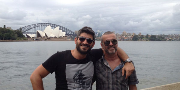 George Michael poses in front of the Sydney Opera House