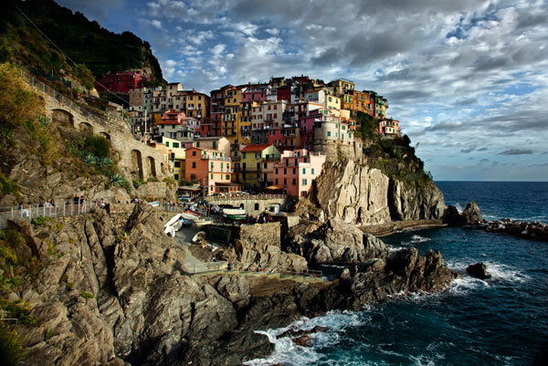 Brightly colored buildings arranged on the edge of a cliff