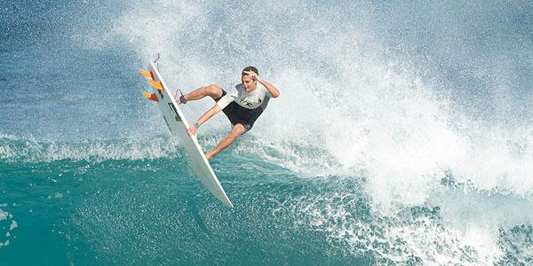 A pro surfer gets air off a big wave