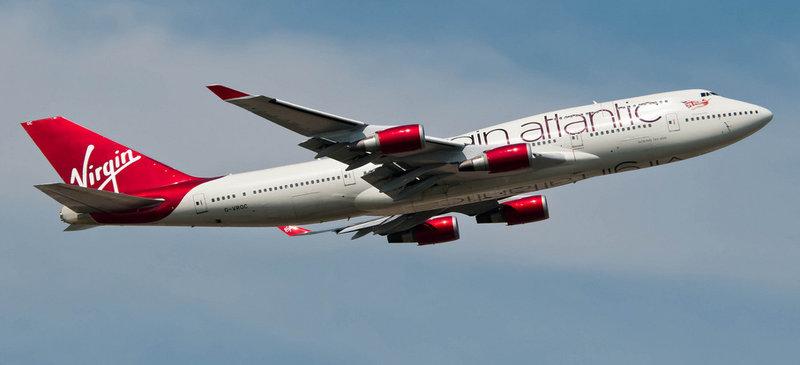 Virgin Atlantic is to offer in-flight mobile phone calls