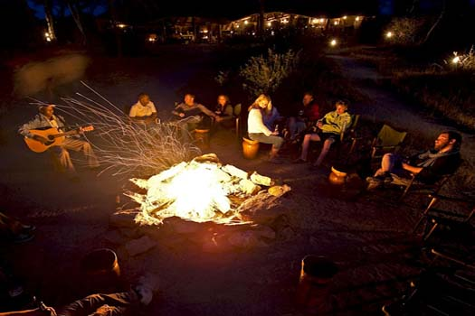 Relax around the camp fire at Oliver's Camp in Tanzania