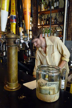 Tipping for drinks at the bar is customary in the US and Canada