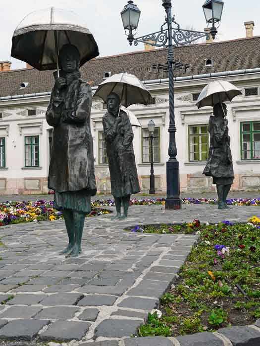Women with umbrellas: bronze statues by Imre Varga in Obuda, Budapest, Hungary