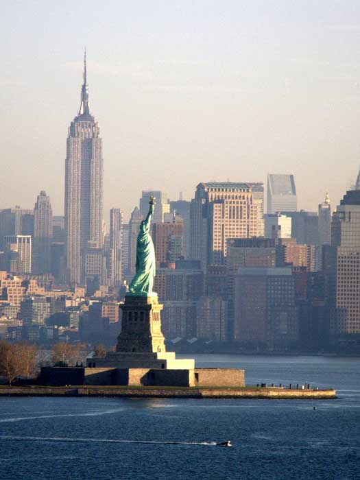 The Statue of Liberty with the Empire State Building in the background