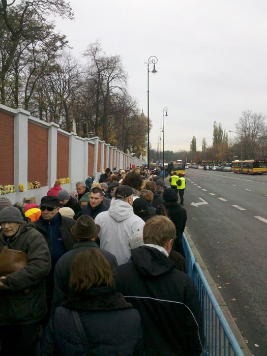 Visitors line up to get inside Powązki Cemetery, Warsaw, on All Saints' Day