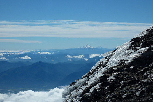 A view of volcanoes - Llaima (front), Tolhuaca (left) and Lonquimay (right).