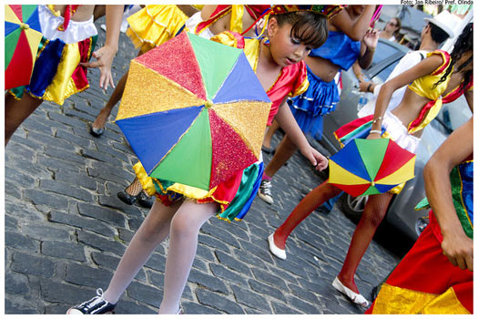 Pack an umbrella like these young revellers