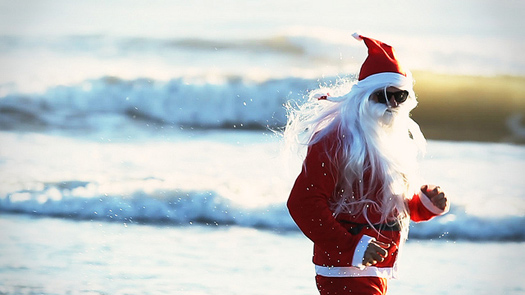 Santa Claus, or Papa Noel, on the beach. Photo:  martinwcox