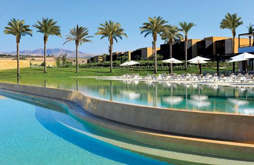 Palm trees, reflective pools and lush greens at Verdura Golf & Spa Resort, Sicily.