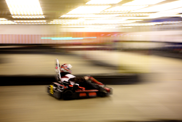 A blurred photo of indoor go karting