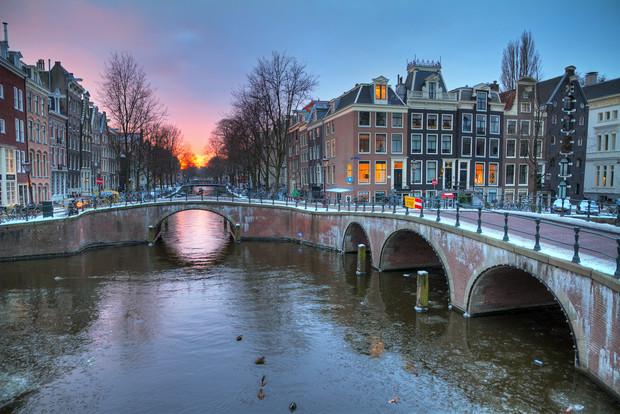Sunrise canal winter Amsterdam