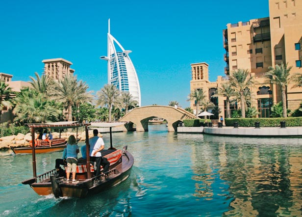 A view of the waterways at the Madinat Jumeirah development, with the Burj Al Arab hotel in the background.